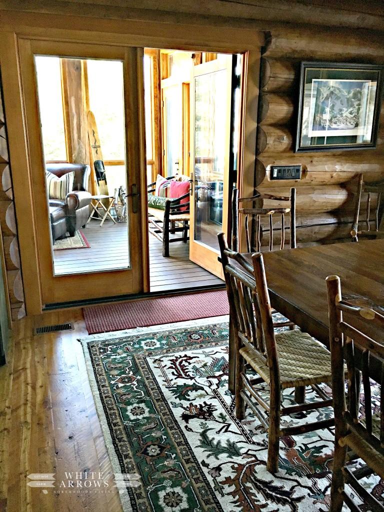 log home, dining room to sunroom