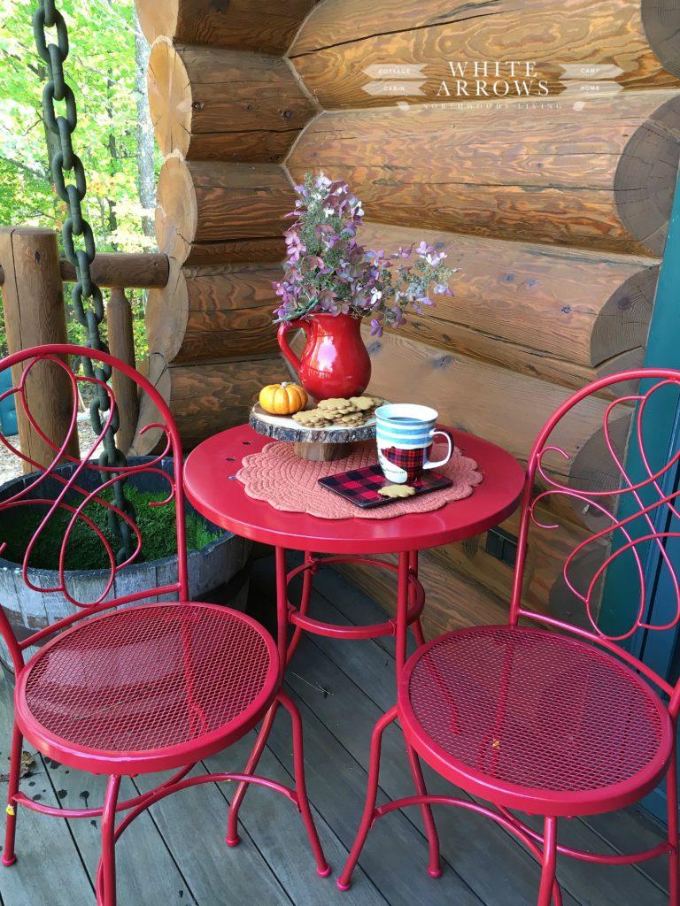 bistro table, fall decor, log cabin